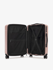 the interior of CALPAK Hue hard shell carry-on spinner luggage in pink sand color