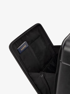 the laptop compartment of CALPAK Hue carry-on suitcase in black color