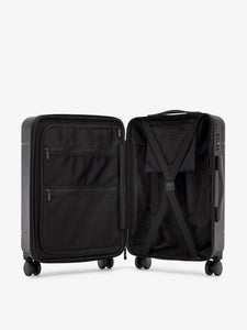 black CALPAK Hue hardside carry on suitcase with laptop compartment and compression straps