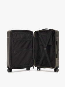 CALPAK Hue hardside carry on suitcase with laptop compartment and compression straps in green moss color