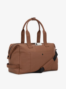 man with brown hazel CALPAK Hue duffel bag