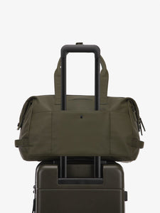 green moss CALPAK Hue duffel bag with luggage trolley sleeve
