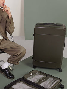 large sturdy luggage in green moss color from CALPAK Hue collection