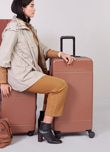 model with check in suitcase and trunk luggage from Hue luggage collection