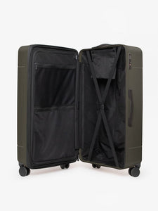 CALPAK Hue trunk suitcase in green moss color with compression straps