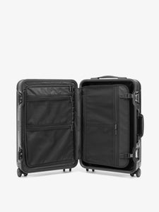 black CALPAK Jen Atkin hard shell carry on luggage with compression