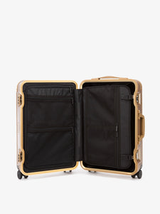 gold CALPAK Jen Atkin hardside carry on luggage with compression