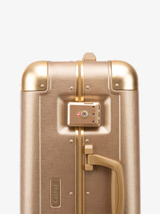 gold CALPAK Jen Atkin zipperless carry on suitcase with TSA lock