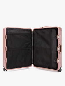 large premium pink rose gold CALPAK Jen Atkin luggage with compression panel