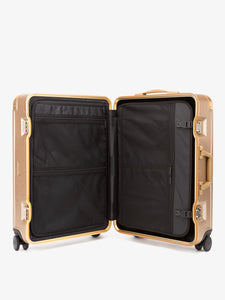 CALPAK Jen Atkin gold premium luggage with compression panel