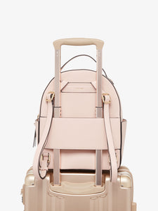 Pink blush CALPAK Kaya backpack with luggage trolley sleeve