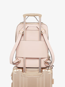 pink blush CALPAK Kaya laptop backpack with luggage trolley sleeve