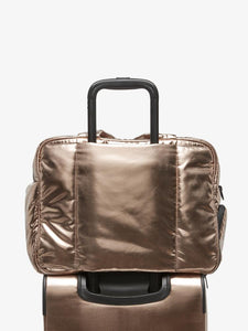 gold bronze CALPAK Luka duffel bag with luggage trolley sleeve