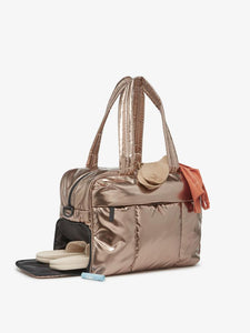 shoe compartment in a gold bronze CALPAK Luka duffel bag