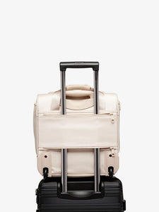 beige nude CALPAK Murphie underseat carry on bag on wheels with luggage trolley sleeve
