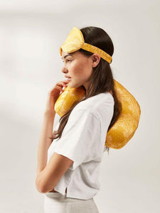 CALPAK travel eye mask and neck pillow in luxurious yellow silk
