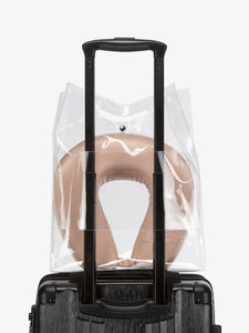 CALPAK rose gold silk travel neck pillow and eye mask in clear carry bag