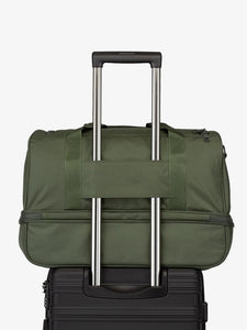 green moss CALPAK Stevyn duffel bag with luggage trolley sleeve