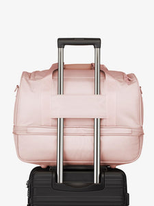 pink sand CALPAK Stevyn duffel bag with luggage trolley sleeve