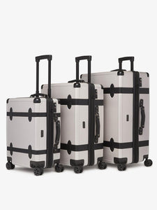 CALPAK TRNK 20 inch grey carry on spinner with 4 wheels in vintage trunk style as a part of TRNK collection