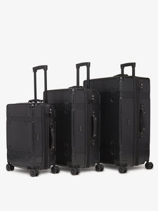 large 29 inch black spinner with 360 wheels in vintage trunk style as a part of CALPAK TRNK luggage collection
