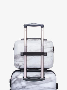 CALPAK white marble vanity case on carry on