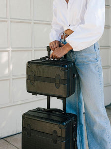 CALPAK TRNK black vanity case and TRNK carry on suitcase modelled