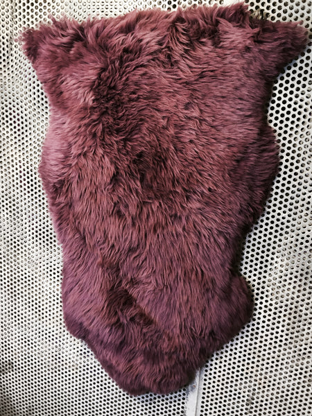 Mulberry red coloured real sheepskin rug