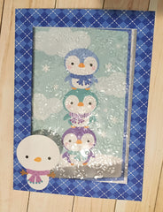Doodlebug Polar Pals card embossed with acetate sheet