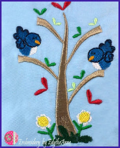 in the hoop blue birds in a tree
