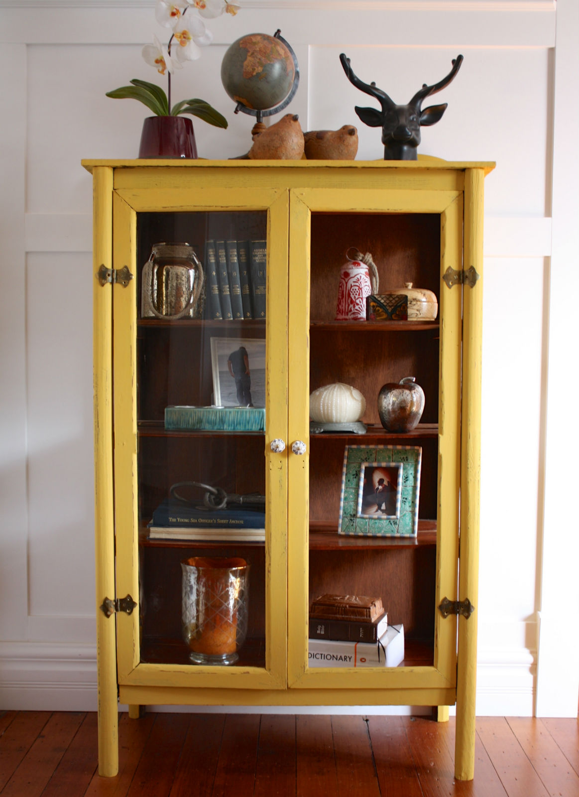 boho mustard yellow glass door cabinet painted with eco-friendly DIY furniture paint by Country Chic Paint