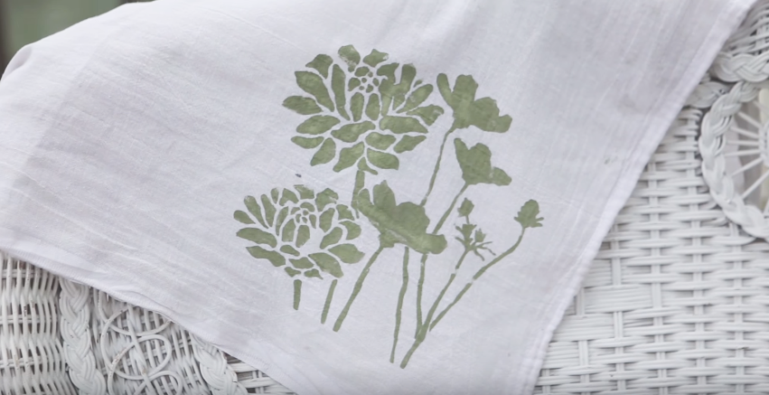 hand painted tea towel with sage green floral design painted with chalk style paint