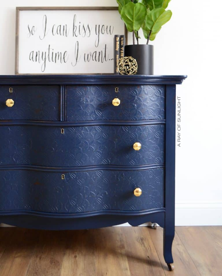 navy blue painted dresser with embossed texture drawer fronts painted with furniture paint and texture powder