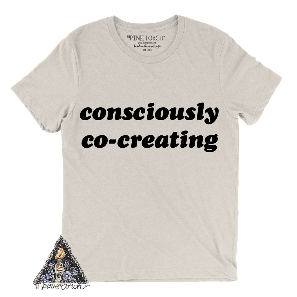 « CONSCIOUSLY CO-CREATING » CREAM, GRAY or BLACK UNISEX TEE