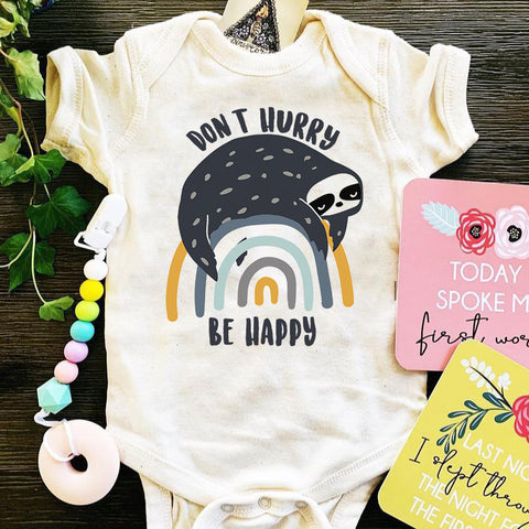 « DON'T HURRY BE HAPPY » BODYSUIT