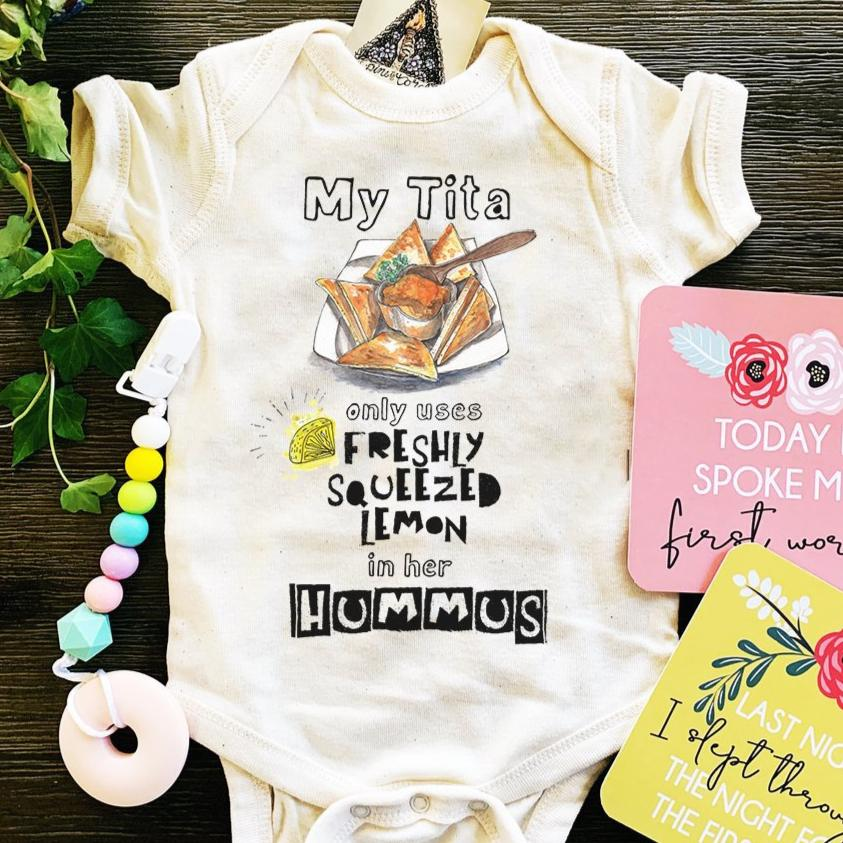 « MY TITA ONLY USES FRESHLY SQUEEZED LEMON ON HER HUMMUS » BODYSUIT