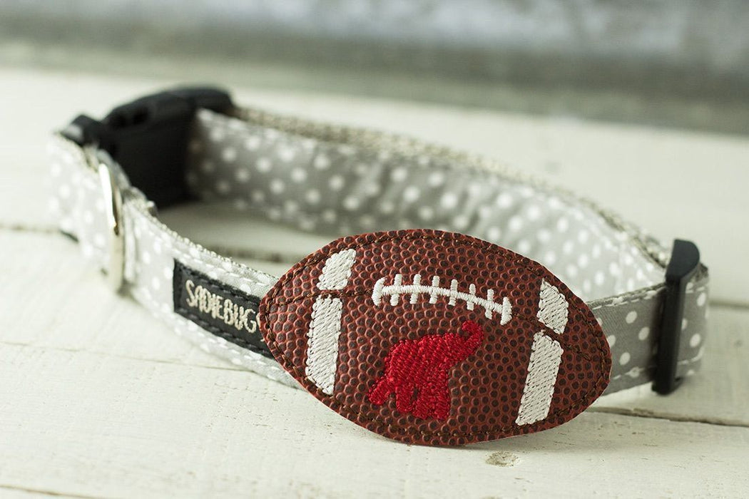Football with elephant dog collar accessory