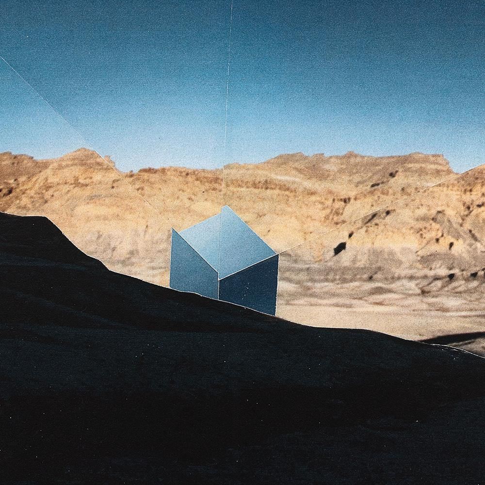 Cube Made of Sky Emerging From Beneath The Shadow of a Prior Mountain