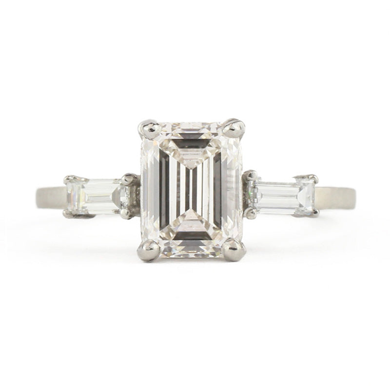 Facet Emerald Cut Three Diamond Platinum Ring