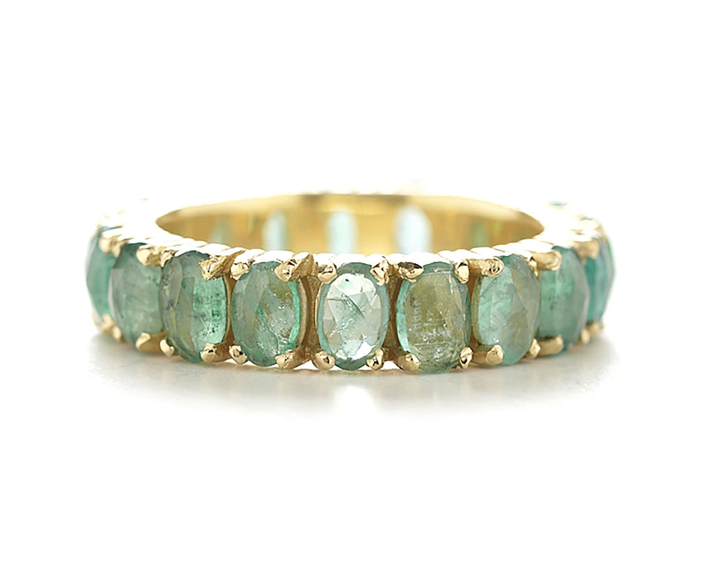 Faceted emerald eternity ring