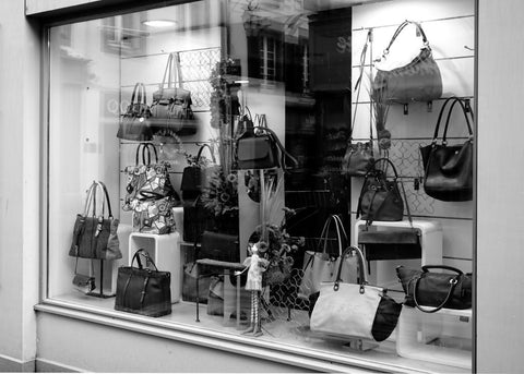 black and white store window with purses