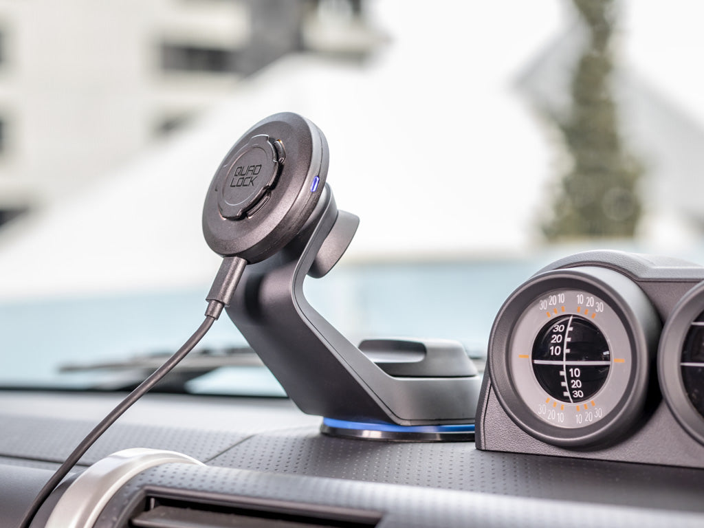 Quad Lock Car Mount with Wireless Charging Head on Dash of Car