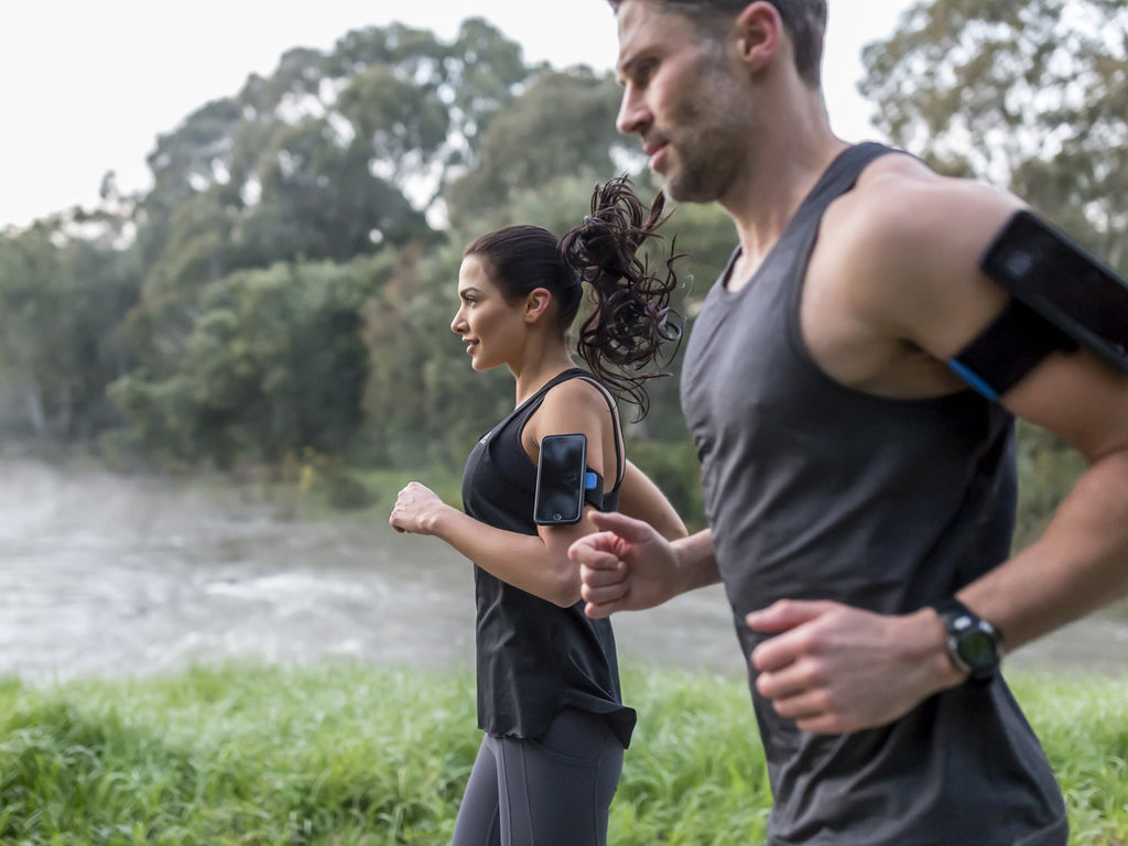 woman and man running with iphone sports armband