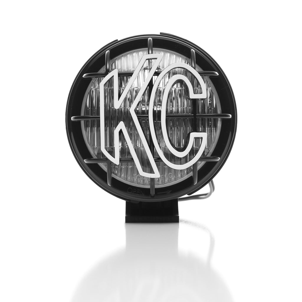 "KC's 5"" Apollo Halogen use 55W Halogen bulbs in a fog beam pattern. Features a slim, black polymax housing and glass lens including rugged, built in stone guards ready to take on the harshest off road terrains. (1452) 