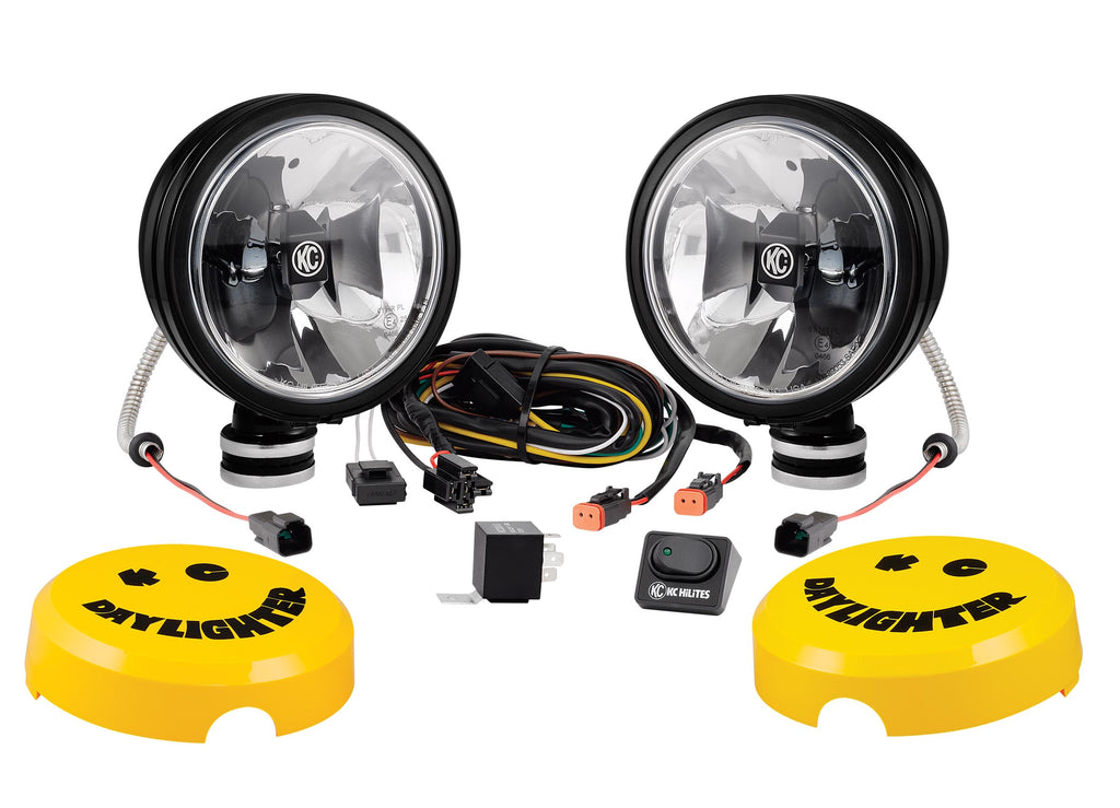 "KC's 6"" Gravity LED Daylighter feature 20w LED bulbs in a SAE legal driving pattern. Black steel housing and polycarbonate lens with FLEXible base for easy aiming. Pair includes complete wiring harness, switches, and ABS stone guards. (653) 