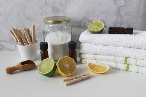 baking soda with towels, lime and lemons
