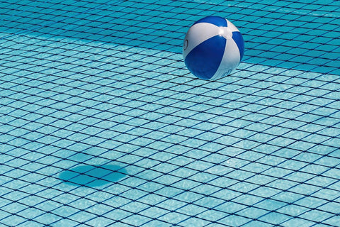 blue and white ball floating on pool