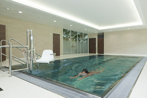 person swimming in an indoor pool