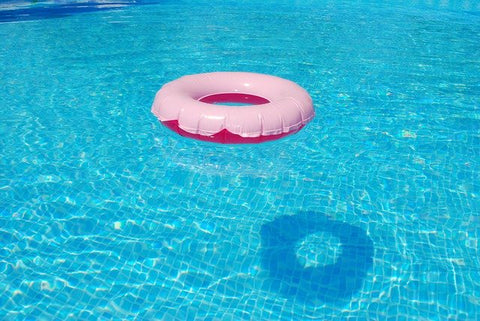 pink floater on pool