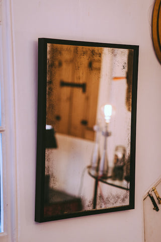 Antiqued Glass Mirror With Black Wooden Frame
